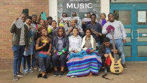 UKZN Music students on Howard College campus with squares and blankets they are currently knitting in preparation for the concert at the Centre for Jazz and Popular Music